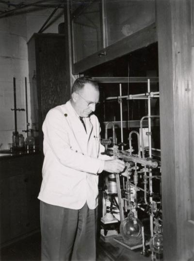 <p>Dr. Joseph Butts, Head of Agricultural Chemistry, adjusting a high vacuum system used to make materials radioactive, ca. 1950s. Butts was a professor of Agricultural Chemistry from 1939-1961 and Department Head from</p><p>				1946-1961. One focus of his interest was utilizing atomic energy for peaceful means.</p>