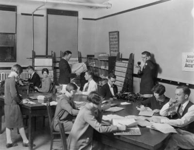 Barometer staff at the copy table, ca. 1930.