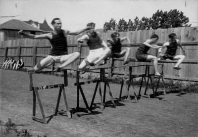 OAC sprinters running the high hurdles, 1905. From left to right: Belden, Graham, Swan, Smithson, Galhey.
