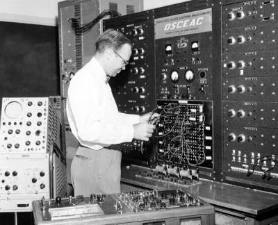 Harvey Christensen (Mechanical Engineering) working on the Oregon State College Electronic Analog Computer (OSCEAC), 1957.