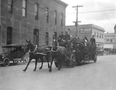 Corvallis Fire Department, 1914. Shown on Madison Street near the Masonic Building and City Hall. Image is of the only horse team the fire department ever had.