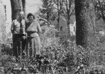 Louis and Lillian Gentner flanked by vigorous plants of  in their garden at 22 S. Groveland Avenue, Medford, Oregon, April 19, 1950.