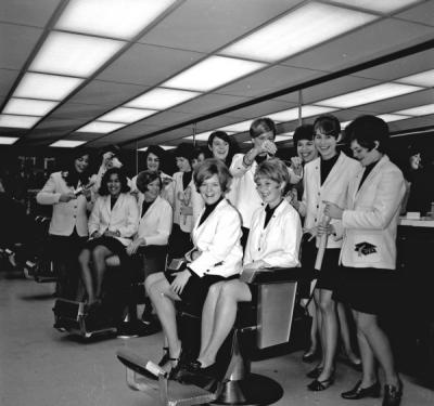 <p>Mortar Board members at a hair salon, ca. 1969. From left to right: Jeanne Fukuji, Helen Pitney, Carol Burroughs, Bobbie Mikkelson, Sheryl Rosvall, Gretchen Heesacker, Carol Setniker, Cathy Beckley, Kristine Paulson, Terri</p><p>				Tower, Nancy Oldfield, Jan Patton, Kris Tonn, and Mary Bartle.</p>