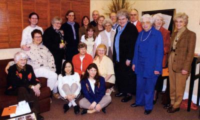 Geraldine Olson, fourth from left (standing), at a gathering organized in her honor, CH2M-Hill Alumni Center, 2002.