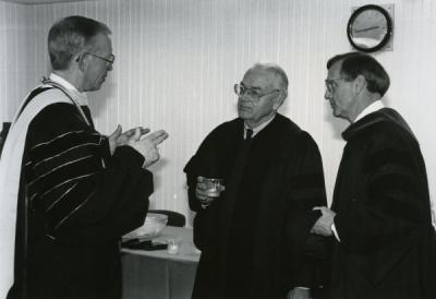 Dr. Dale Parnell (middle) speaking with Vincennes University president Phillip M. Summers and VU Vice President David Ford prior to VU's 185th commencement exercises, April 27, 1991.