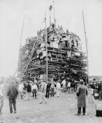 "<p>Rook bonfire, 1930. For the 1930 Homecoming the rooks (freshmen) gathered fuel from all over Corvallis and built ""the greatest woodpile ever hauled to the campus"" on the lot between Waldo Hall and McAlexander Fieldhouse</p><p>				(near the current site of Snell Hall). The bonfire burned on the Friday night preceding Oregon State's homecoming football game against the University of Oregon. The Beavers shut out the Ducks 15-0 in that game.</p>"