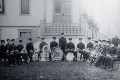 Corvallis High School Band in front of the Christian Church on 4th and Madison, Corvallis, Oregon, ca. 1900.
