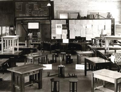 <p>Industrial Arts workshop, ca. 1910s. Image shows examples of furniture designed and constructed by Oregon Agricultural College students. The cabinet work course included the mixing and application of stains, fillers, and</p><p>				various finishes; the design and construction of drawers and panel work; and primary upholstering. Many of O. A. C.'s industrial arts students became teachers at the secondary and vocational level.</p>