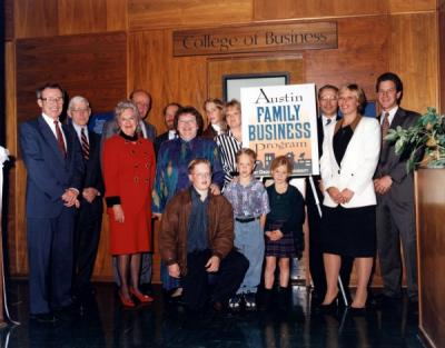 The Austin Family with President John Byrne at the dedication of the Austin Family Business Program, 1995.