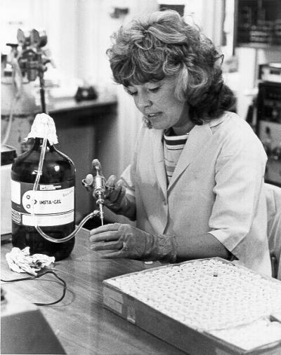 A researcher in the laboratory, ca. 1983. Research like that featured here begins not in the bottles of a lab shelf, but in the files of the Research Office, which coordinates and oversees all research projects at OSU's schools and colleges, as well as the numerous multi-disciplinary research centers and institutes managed by the University. In addition to reports summarizing grant projects, the records of the Research Office include minutes from committees involved in research and handbooks on research procedures and guidelines.