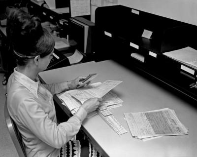 A University Archives student arranging records for filing, ca. 1970s.