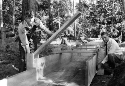 Arthur King, soil specialist, demonstrating how to build a flume, ca. 1930.