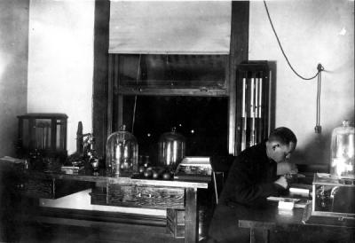 An entomologist in the laboratory, ca 1910s.