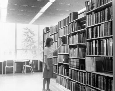 A student browsing in the Kerr Library, 1966.