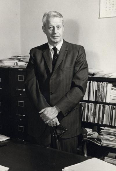 Henry P. Hansen standing in his office, ca. 1960s. Hansen came to Oregon State College in 1939 as an Instructor in Botany. He became Dean of the Graduate School in 1949, a position he held until his retirement in 1971.