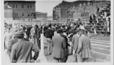 Scene from a home track meet [?] versus the University of Washington, ca. 1920s. Photo sold by Graham & Wells.