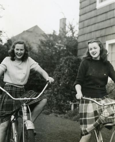 Sigma Kappa sorority members bicycling near campus, 1944.