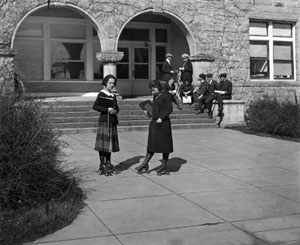 Oregon Agricultural College co-eds rollerskating to class, early 1920s.
