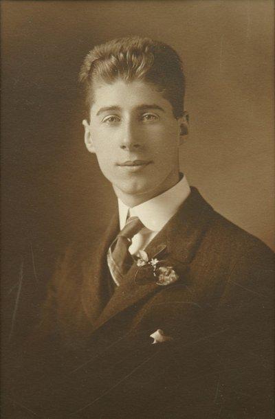 Sepia-tone studio portrait of Roger Hayward as a high school senior.