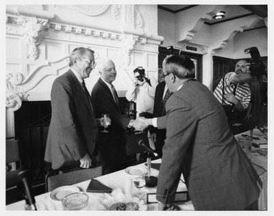 Black and white photograph of Paul G. Risser meeting John Vincent Byrne.