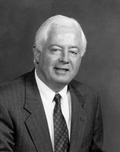 Black and white photographic portrait of Paul G. Risser.