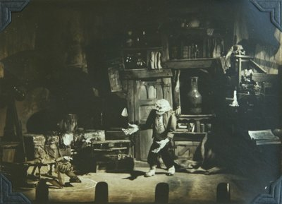 """Black and white photograph of a scene from """"The Sorcerer's Apprentice"""" puppet show."""