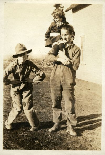 Owen, Helen and Chester Searcy on the family farm