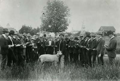 Agriculture Students with a Sheep, ca. 1900