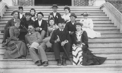 Black and white photograph of John McKnight Bloss with students.