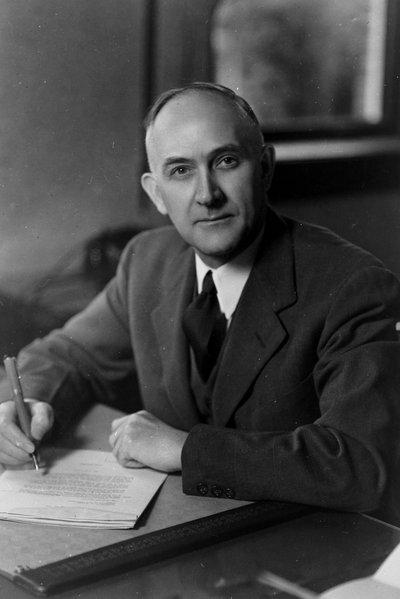 Black and white photograph of Francois Archibald Gilfillan at his desk.