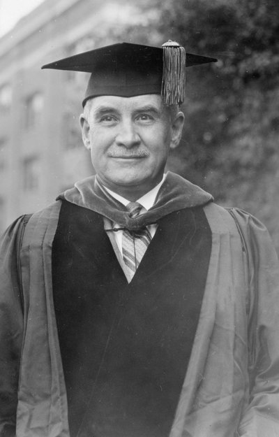 Black and white photograph of William Jasper Kerr in cap and gown.