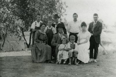 Thomas and Lena Searcy and family at farm house